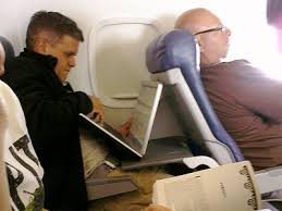 Laptop crammed in a plane